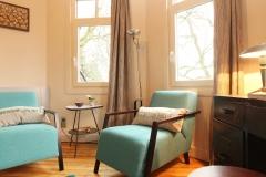 Villa Emma Gent: zetelhoek in gastenkamer Acacia